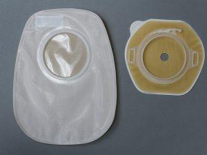 Bi-component ostomy systems